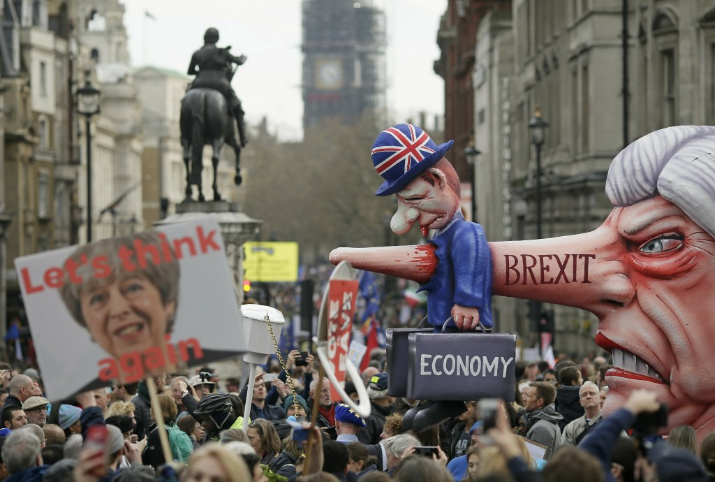 An effigy of British Prime Minister Theresa May is wheeled through Trafalgar Square during a Peoples Vote anti-Brexit march in London, Saturday, March