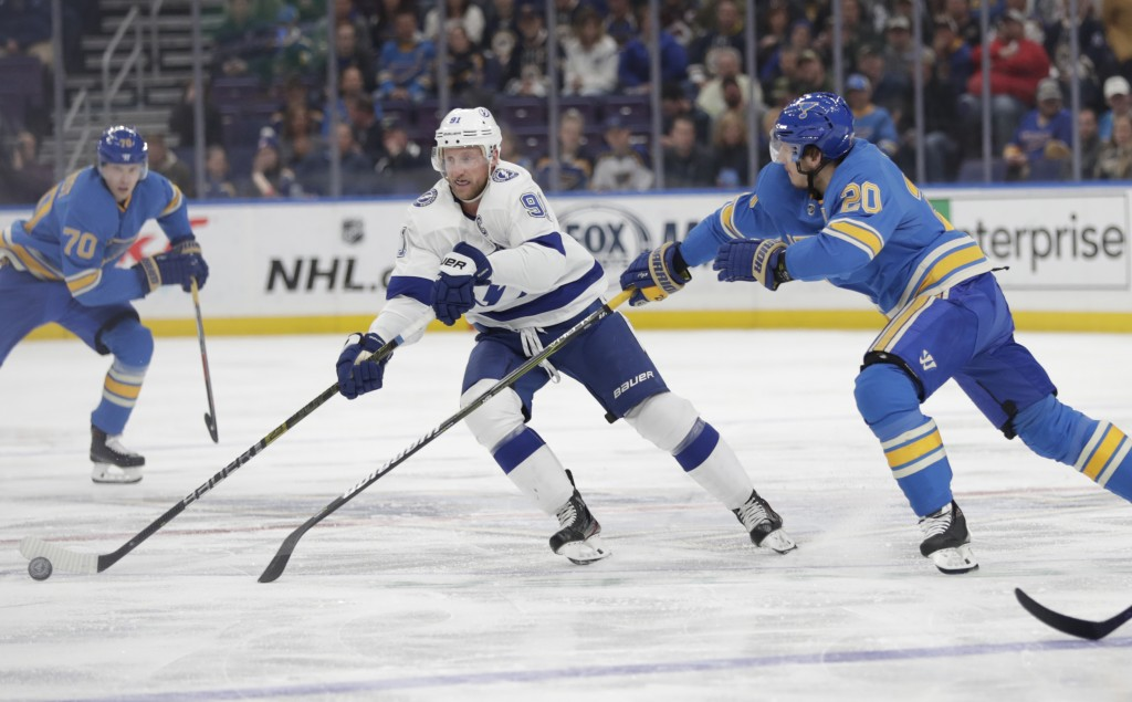 Tampa Bay Lightning's Steven Stamkos (91) tries to skate past the outstretched stick of St. Louis Blues' Alexander Steen (20) in the first period of a