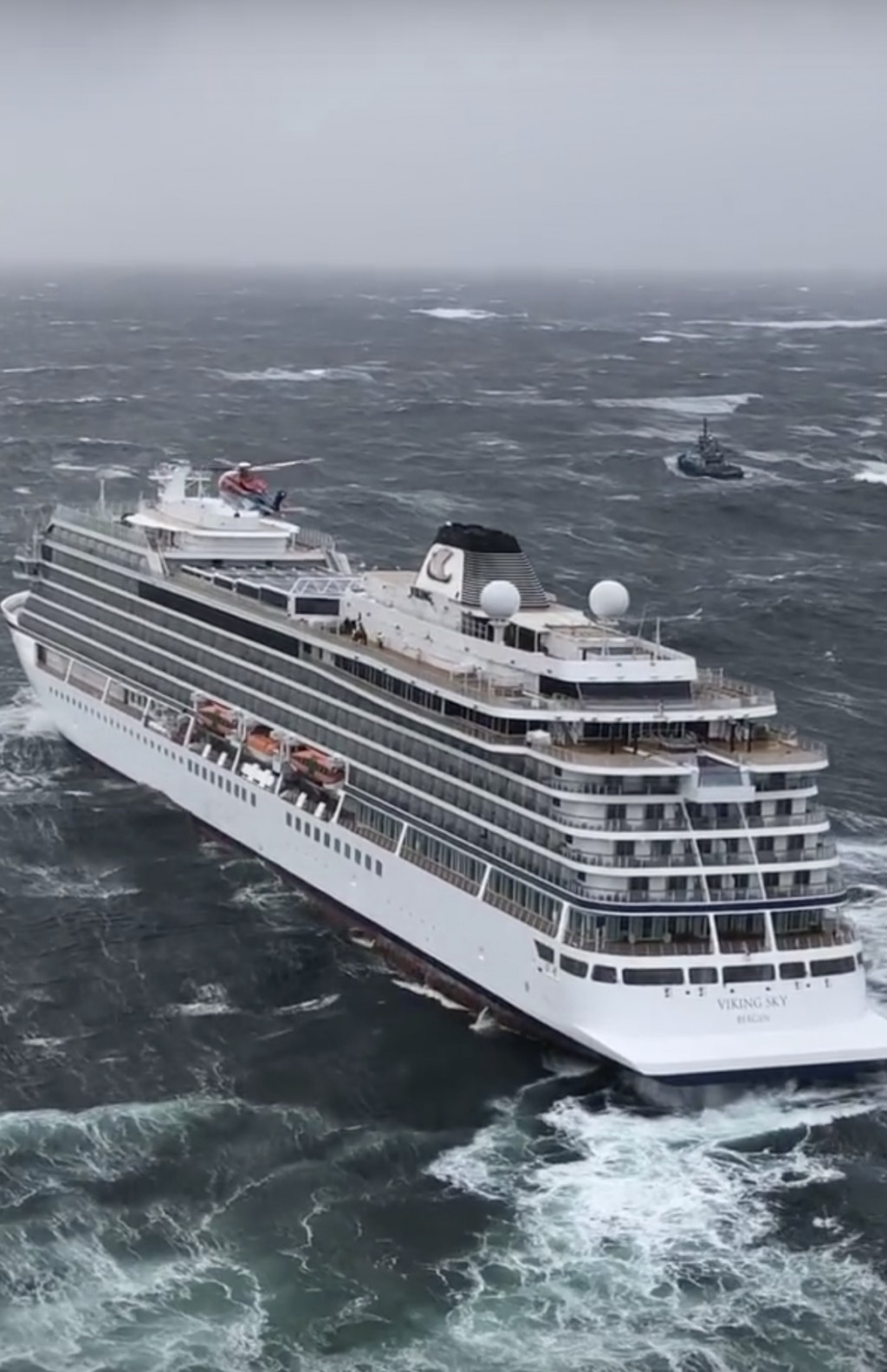 In this image taken from video made available by CHC helicopters, helicopters fly over the cruise ship Viking Sky after it sent out a Mayday signal be