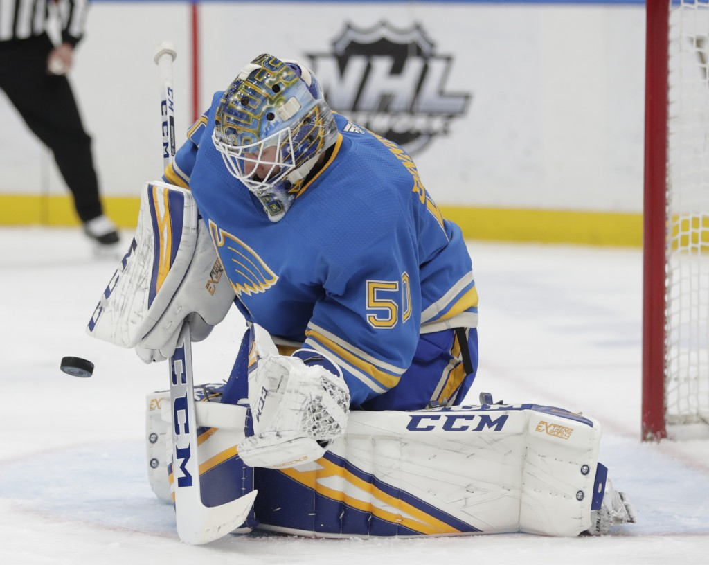 St. Louis Blues goaltender Jordan Binnington (50) makes a stick-save in the first period of an NHL hockey game against the Tampa Bay Lightning, Saturd