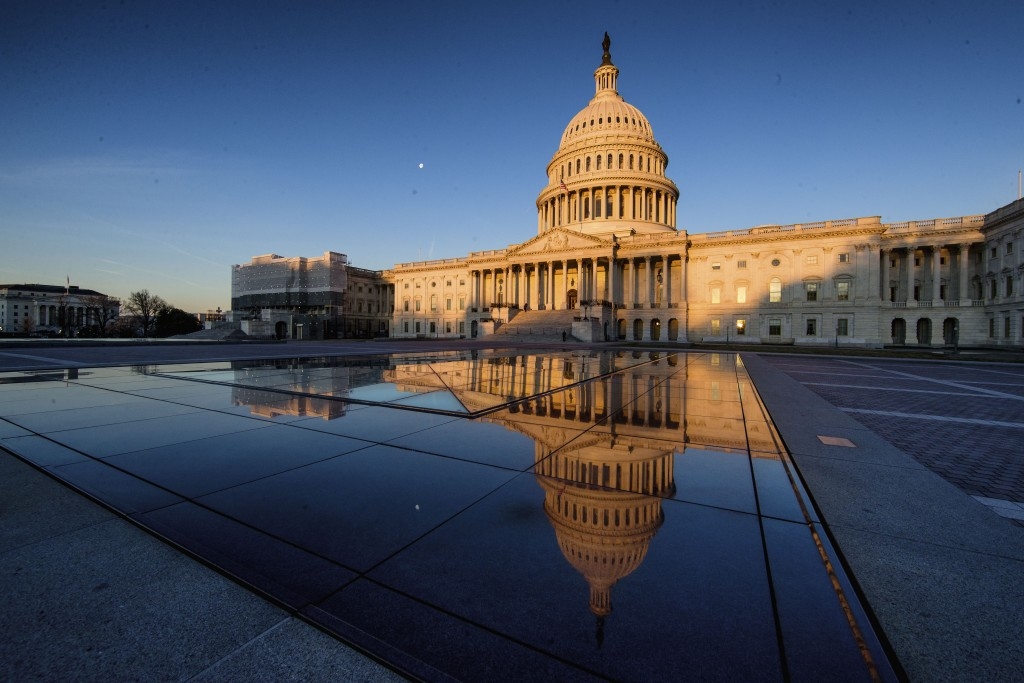 The U.S Capitol is seen at sunrise, Sunday, March 24, 2019, in Washington.  The special counsel's report on how the Russians tried to influence the 20