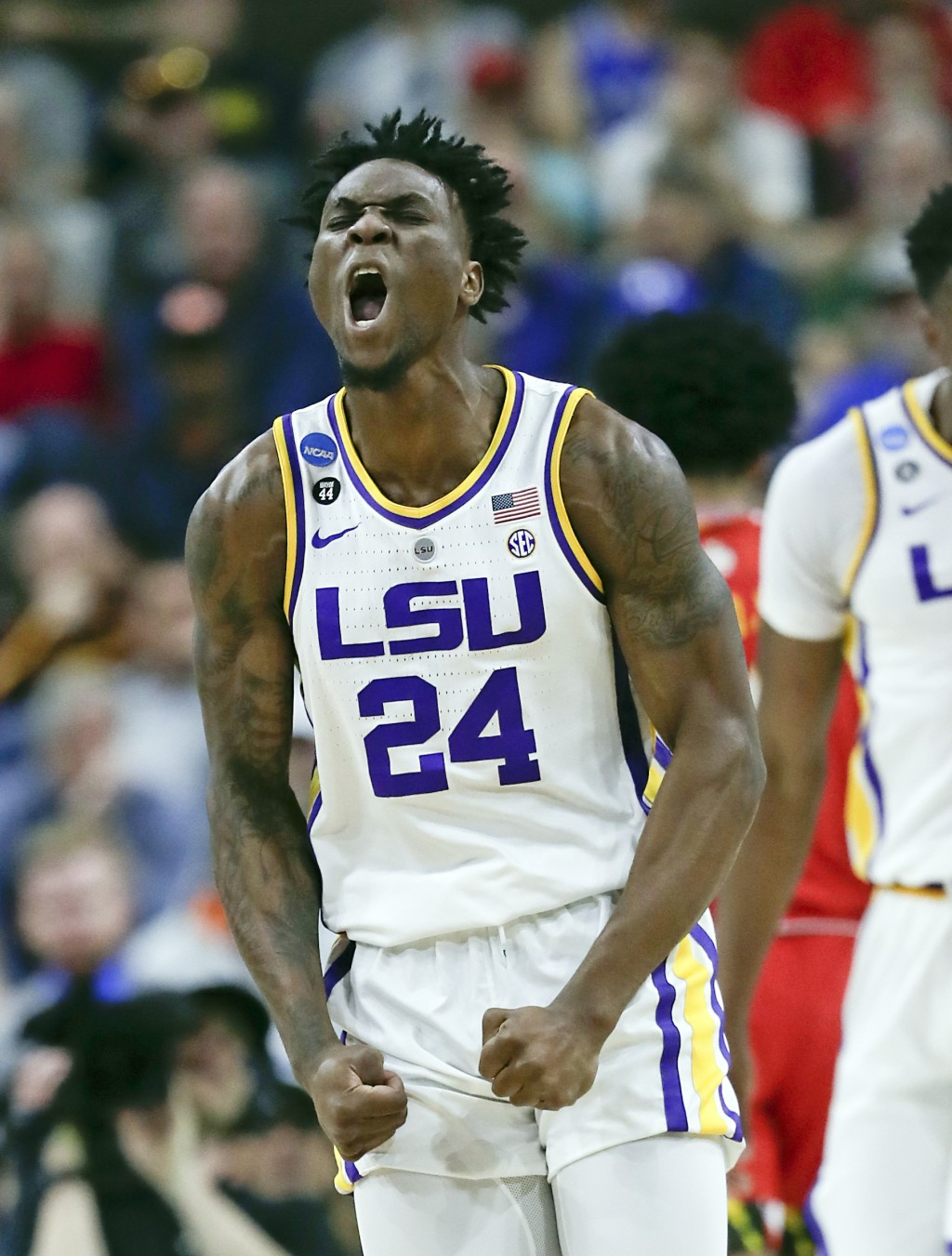 LSU's Emmitt Williams (24) celebrates after making a shot against Maryland during the first half of a second-round game in the NCAA men's college bask...