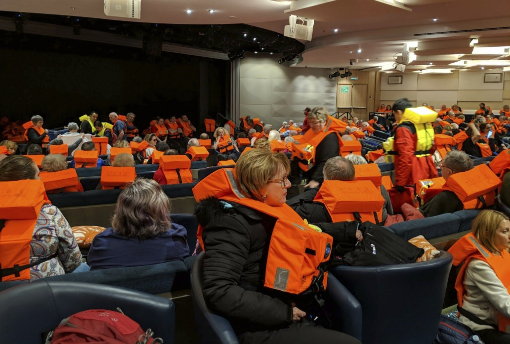 This photo provided by Michal Stewart shows passengers on board the Viking Sky, waiting to be evacuated, off the coast of Norway on Saturday, March 23