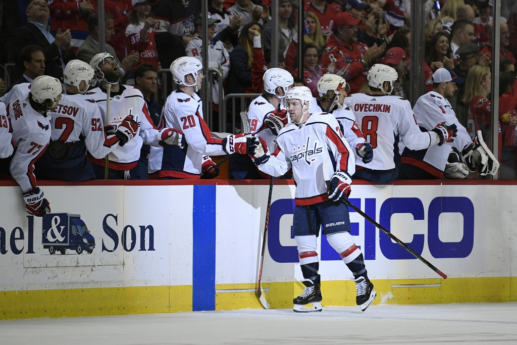 Washington Capitals center Travis Boyd (72) celebrates his goal with the bench during the second period of an NHL hockey game against the Philadelphia