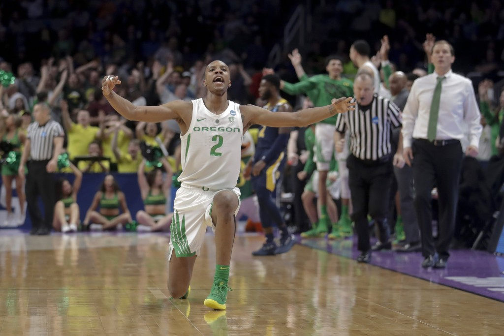 Oregon forward Louis King celebrates after scoring against UC Irvine during the second half of a second-round game in the NCAA men's college basketbal