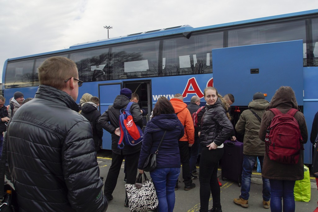 Ukrainians disembark the Kharkiv-Warsaw bus in Warsaw, Poland, on March 10, 2019. As Ukrainians prepare to go to the polls in a presidential election