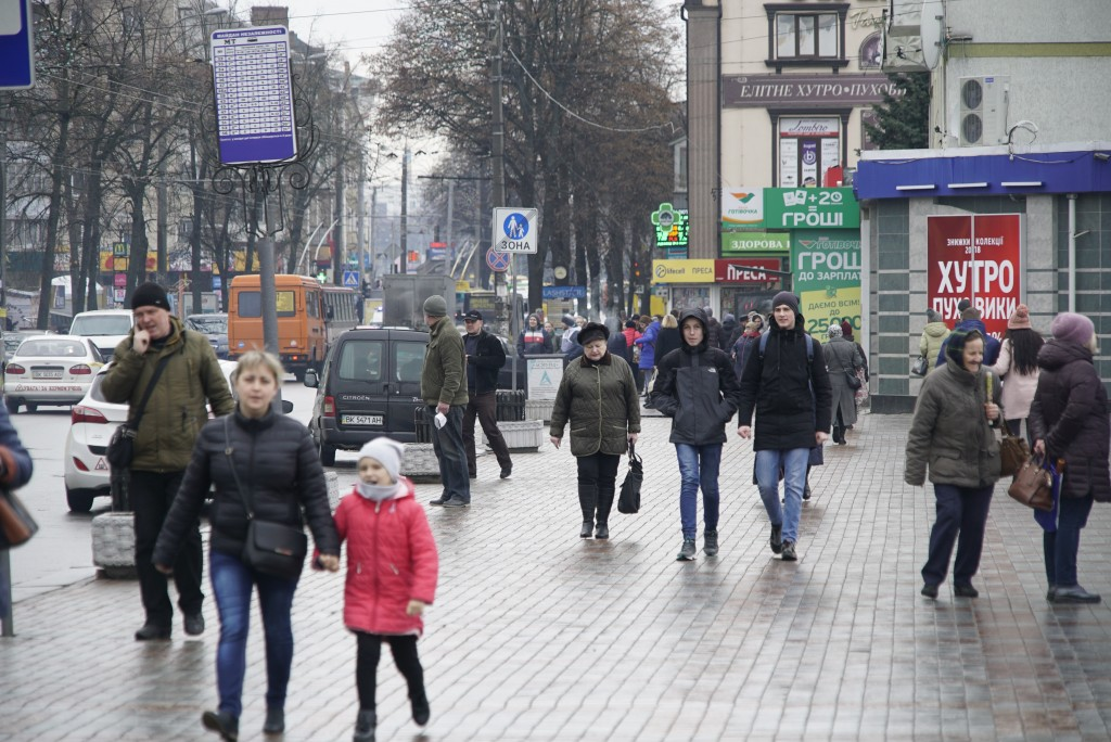 People walk along the street of Rivne, Ukraine, on March 14, 2019.  As Ukrainians prepare to go to the polls in a presidential election March 31, mill