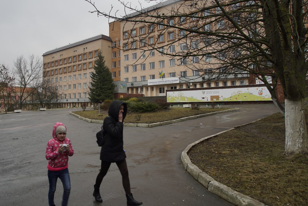 Mother and daughter walk away from the Rivne Regional Children's Hospital, in Rivne, Ukraine, on March 14, 2019.  As Ukrainians prepare to go to the p