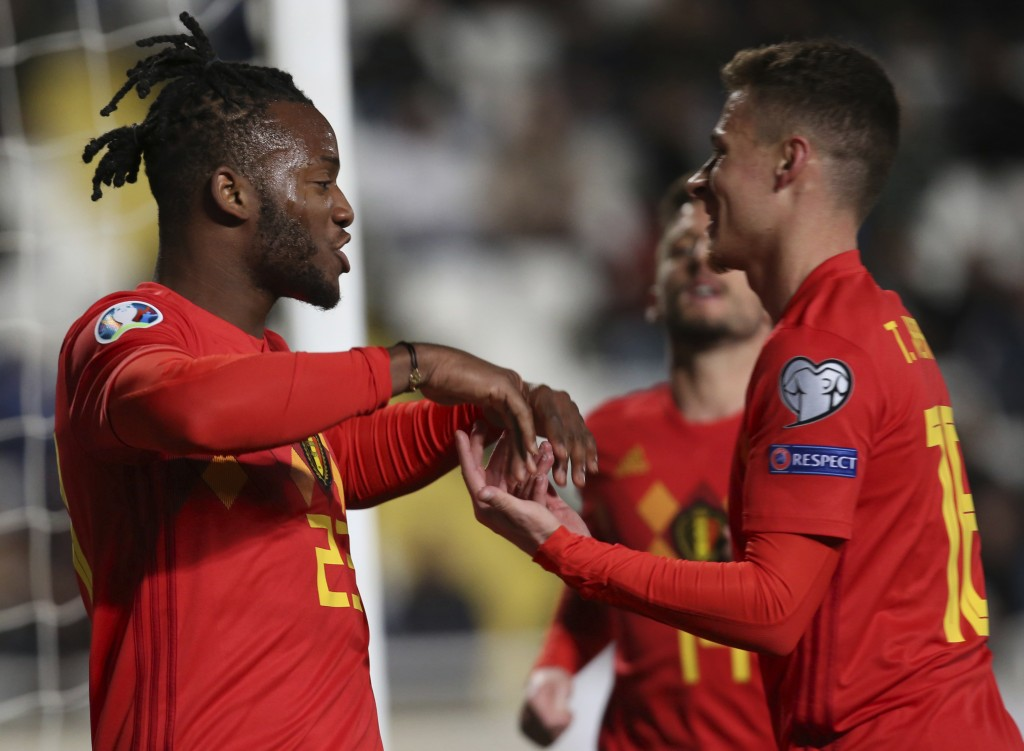 Belgium player Michy Batshuayi, left, celebrates a goal against Cyprus during the Euro 2020 group I qualifying soccer match between Cyprus and Belgium
