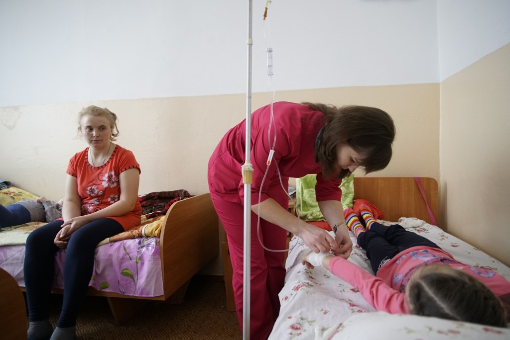 Nurse attends the child in Rivne Regional Children's Hospital, Ukraine on March 14, 2019. As Ukrainians prepare to go the polls in a presidential elec