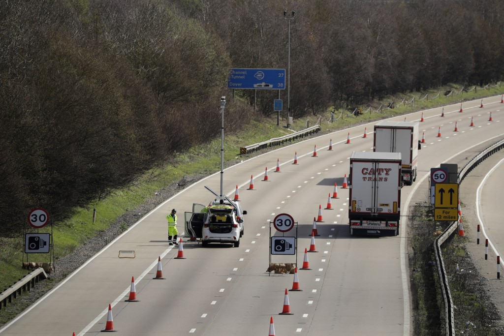 On the first day of Operation 'Brock', (Brexit Operations Across Kent) trucks pass through a contraflow system being tested on one side of the M20 mot