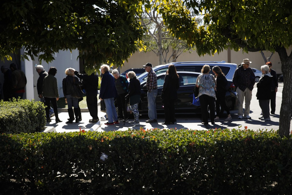 In this Feb. 19, 2019 photo, a group of retired seniors from Laguna Woods Village form a line outside Bud and Bloom cannabis dispensary to attend a pr