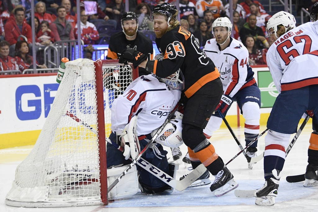 Philadelphia Flyers right wing Jakub Voracek (93), of the Czech Republic, collides with Washington Capitals goaltender Braden Holtby (70) during the s
