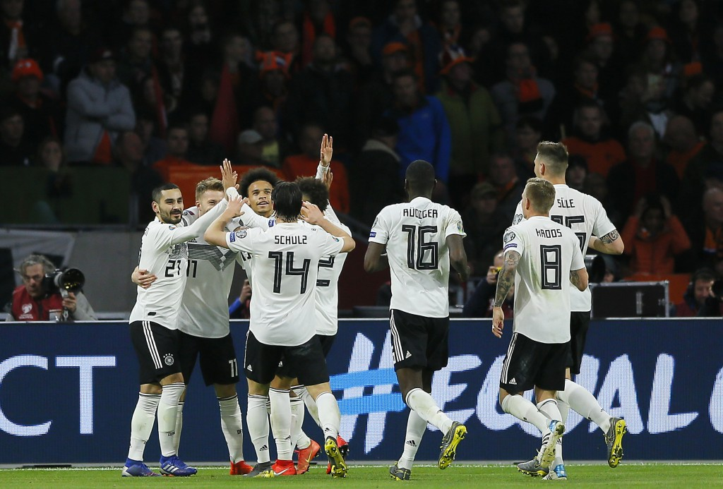 Germany's Nico Schulz, fourth from left, celebrates with his teammates after scoring his side's third goal during the Euro 2020 group C qualifying soc