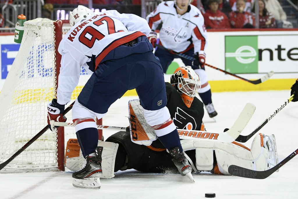 Philadelphia Flyers goaltender Brian Elliott (37) looks at the puck during the first period of an NHL hockey game against Washington Capitals center E