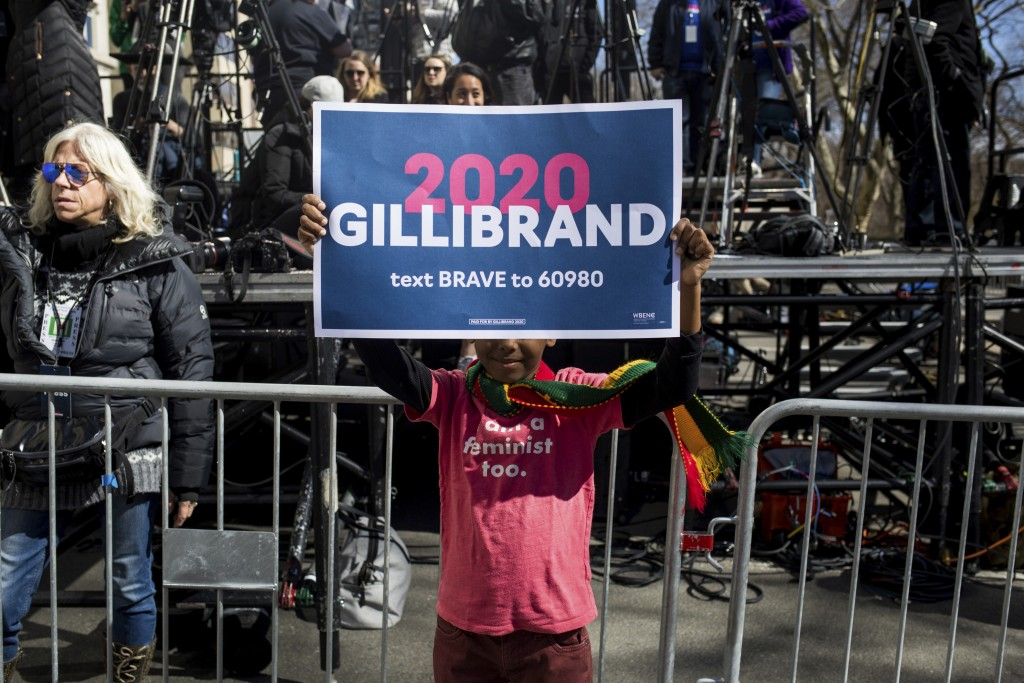 "Ray Frederick, 7, holds a sign that reads ""2020 Gi..."