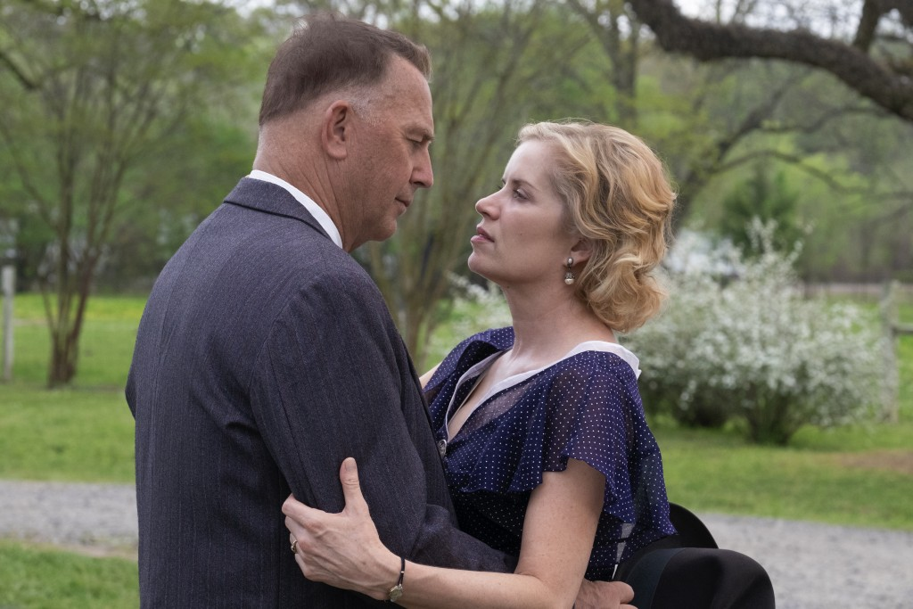 "This image released by Netflix shows Kevin Costner and Kim Dickens, right, in a scene from ""The Highwaymen."" (Merrick Morton/Netflix via AP)"