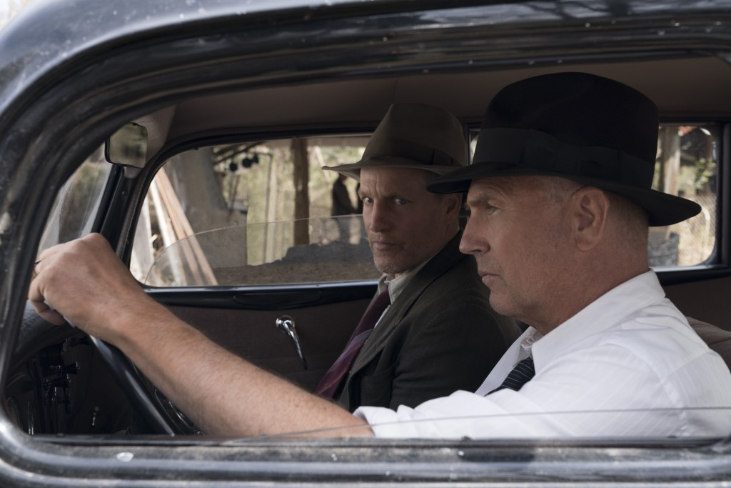 "This image released by Netflix shows Woody Harrelson, left, and Kevin Costner in a scene from ""The Highwaymen."" (Hilary B Gayle/Netflix via AP)"