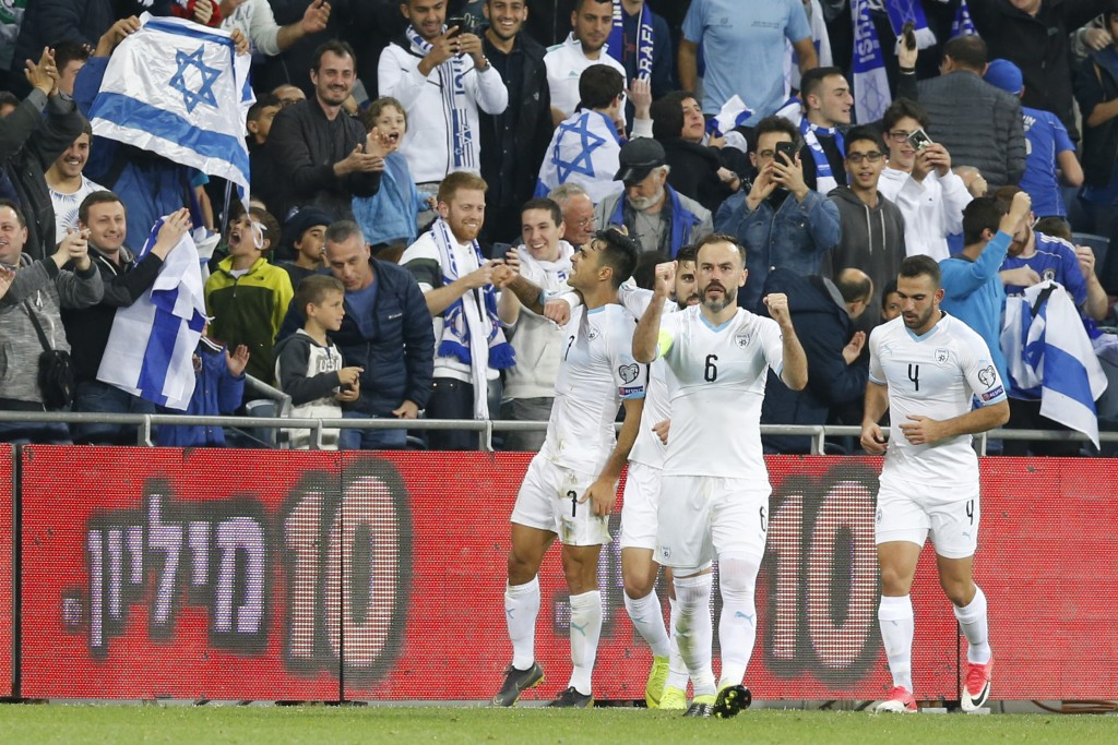 Israel's Eran Zahavi and teammates celebrate after scoring during the Euro 2020 group G qualifying soccer match between Austria and Israel, in Haifa,