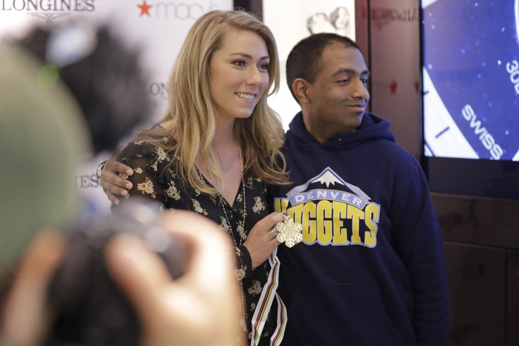 Mikaela Shiffrin poses for photographs with fans at Macy's Thursday, March 21, 2019, in New York. The 24-year-old American spent time in New York to c