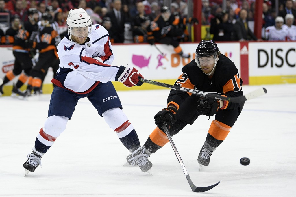 Washington Capitals defenseman Nick Jensen (3) battles for the puck against Philadelphia Flyers left wing Michael Raffl (12) during the second period
