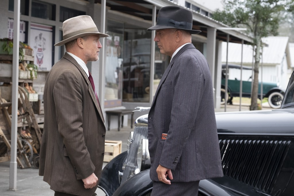 "This image released by Netflix shows Woody Harrelson, left, and Kevin Costner in a scene from ""The Highwaymen."" (Merrick Morton/Netflix via AP)"