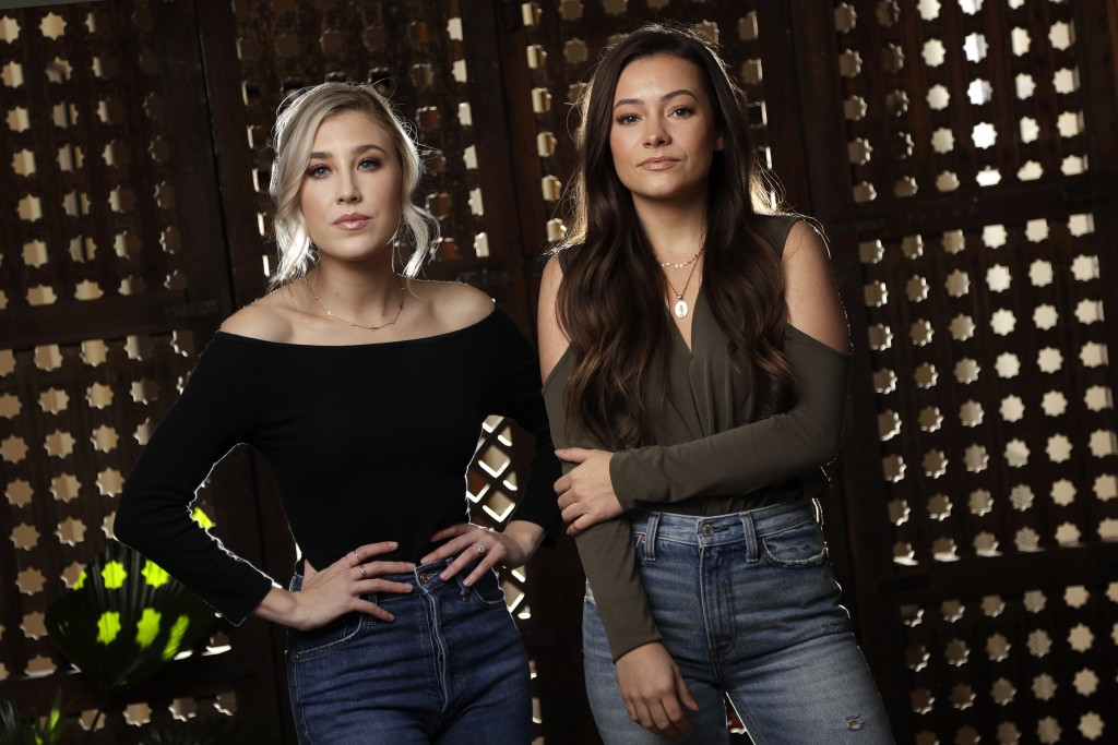 In this March 20, 2019, photo, Madison Marlow, left, and Taylor Dye, of the duo Maddie & Tae, pose in Nashville, Tenn. Nearly four years after their f...