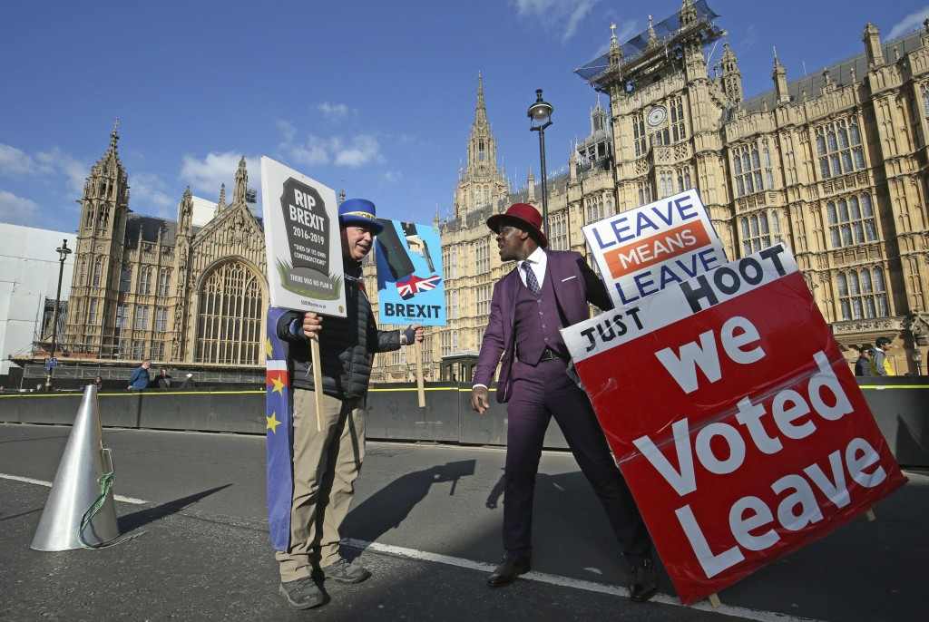 Protestors for opposing views face off against each other, with pro-Brexit split from Europe at right, and pro-Europe anti Brexit at left, outside par...