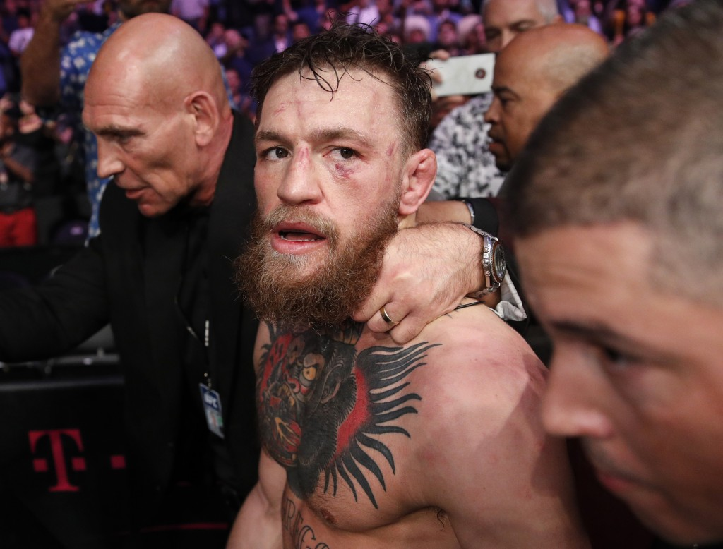 FILE - In this Oct. 6, 2018, file photo, Conor McGregor walks out of the arena after he was defeated by Khabib Nurmagomedov in a lightweight title mix