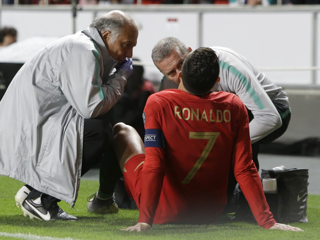 Portugal's Cristiano Ronaldo receives treatment from medical staff during the Euro 2020 group B qualifying soccer match between Portugal and Serbia at...