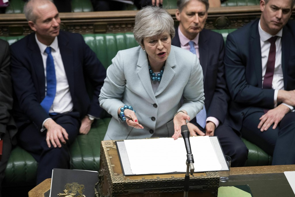 In this handout photo provided by the UK Parliament, Britain's Prime Minister Theresa May makes a statement on Brexit to the House of Commons, London,...