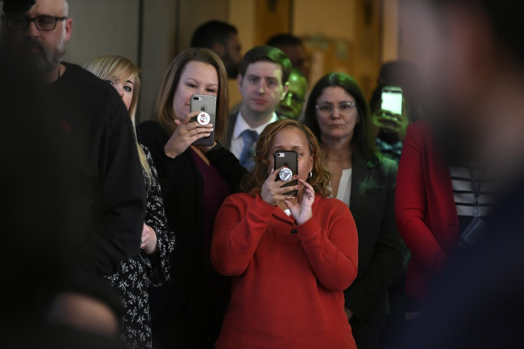 Onlookers take video with their phones while actor Jussie Smollett talks to the media at Cook County Court after his charges were dropped Tuesday, Mar...