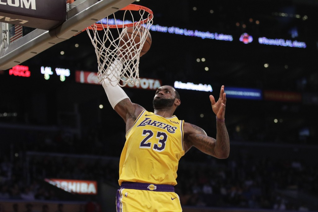 e00b14014d7c Los Angeles Lakers  LeBron James goes up for a dunk during the first half of
