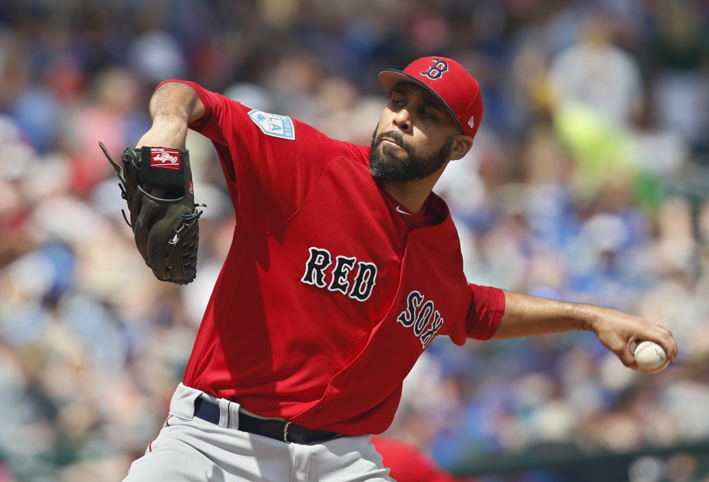 Boston Red Sox pitcher David Price pitches in the first inning of a spring training baseball game against the Chicago Cubs Tuesday, March 26, 2019, in...