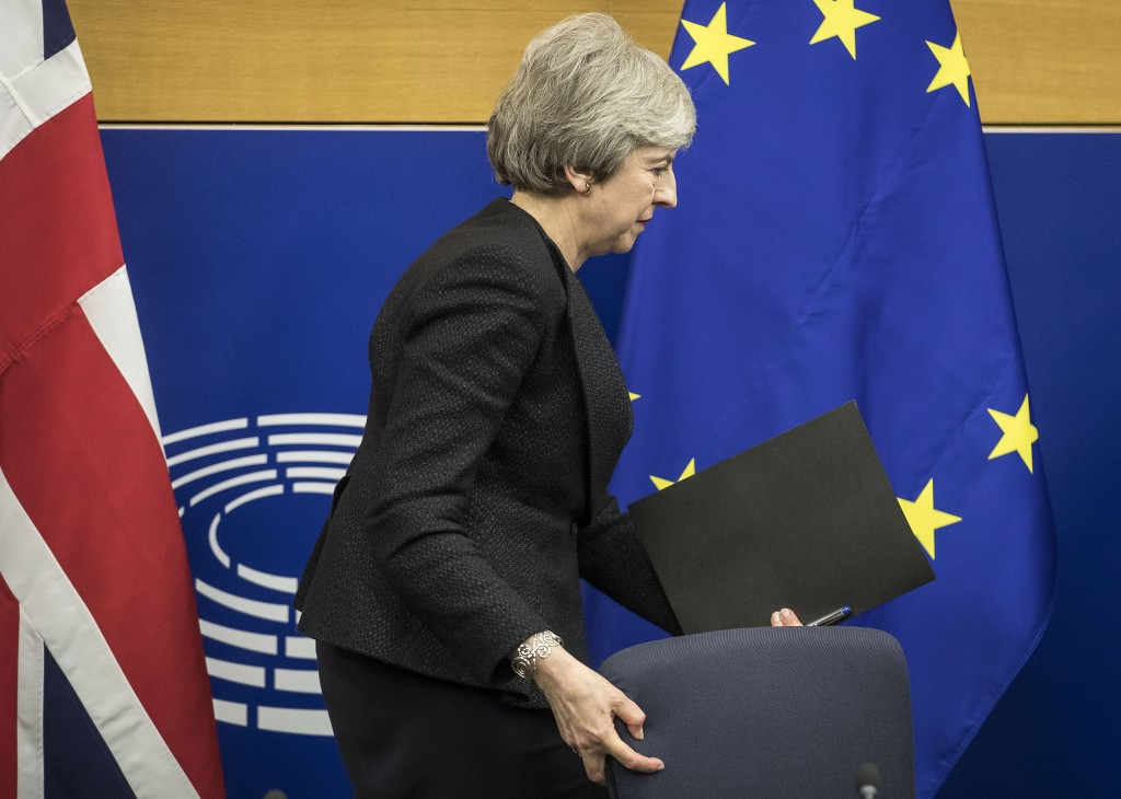 FILE - In this Monday, March 11, 2019 file photo, British Prime Minister Theresa May leaves after a media conference at the European Parliament in Str