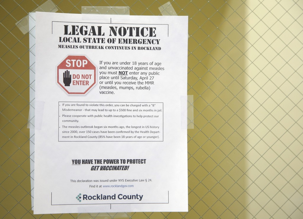 A sign explaining the local state of emergency is displayed at the Rockland County Health Department in Pomona N.Y. Wednesday