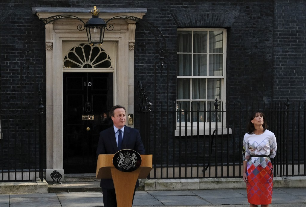 FILE - In this Friday, June 24, 2016 file photo, British Prime Minister David Cameron speaks outside 10 Downing Street, London as his wife Samantha lo
