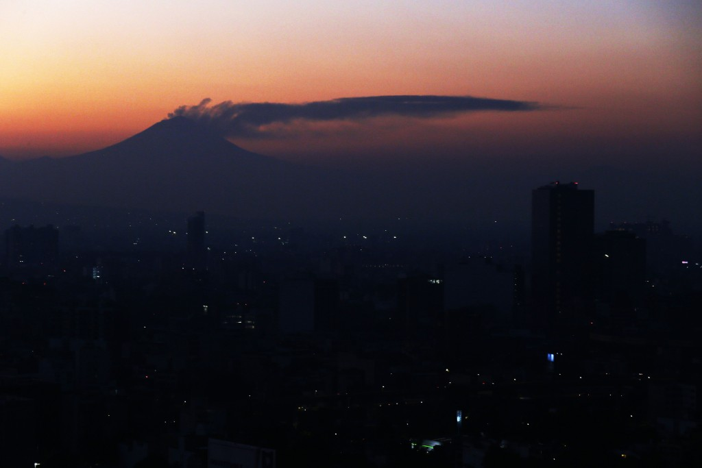 A plume of ash and steam emanates from the Popocatepetl volcano, as seen from Mexico City, Thursday, March 28, 2019. The country's disaster prevention...