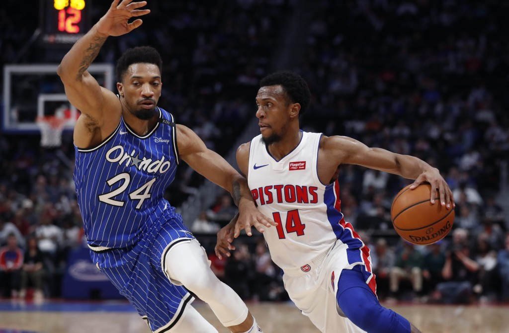 Detroit Pistons guard Ish Smith (14) drives on Orlando Magic center Khem Birch (24) during the first half of an NBA basketball game Thursday, March 28...