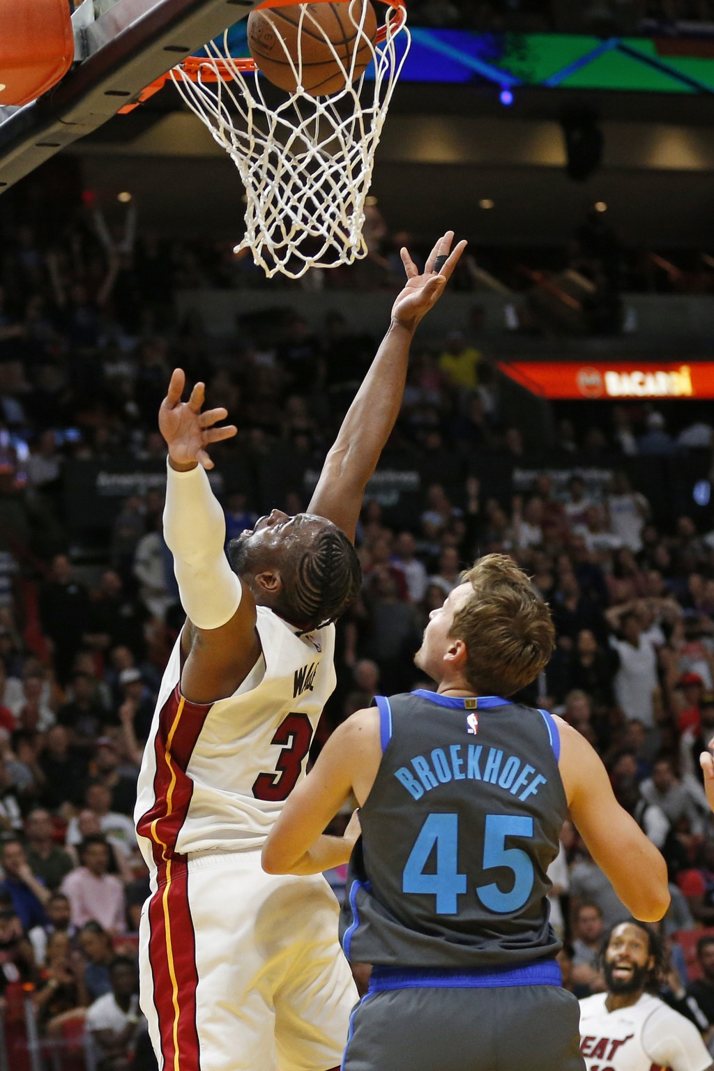 Miami Heat guard Dwyane Wade (3) scores the final basket of the game against Dallas Mavericks guard Ryan Broekhoff (45) during the second half of an N