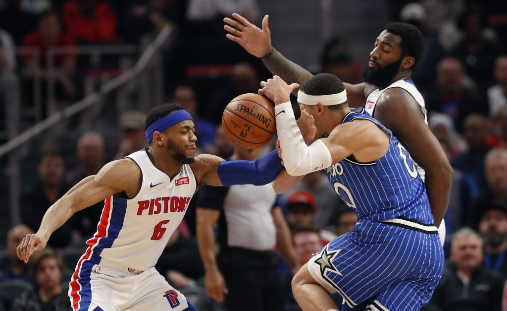 Detroit Pistons guard Bruce Brown (6) knocks the ball away from Orlando Magic forward Aaron Gordon (00) during the first half of an NBA basketball gam...