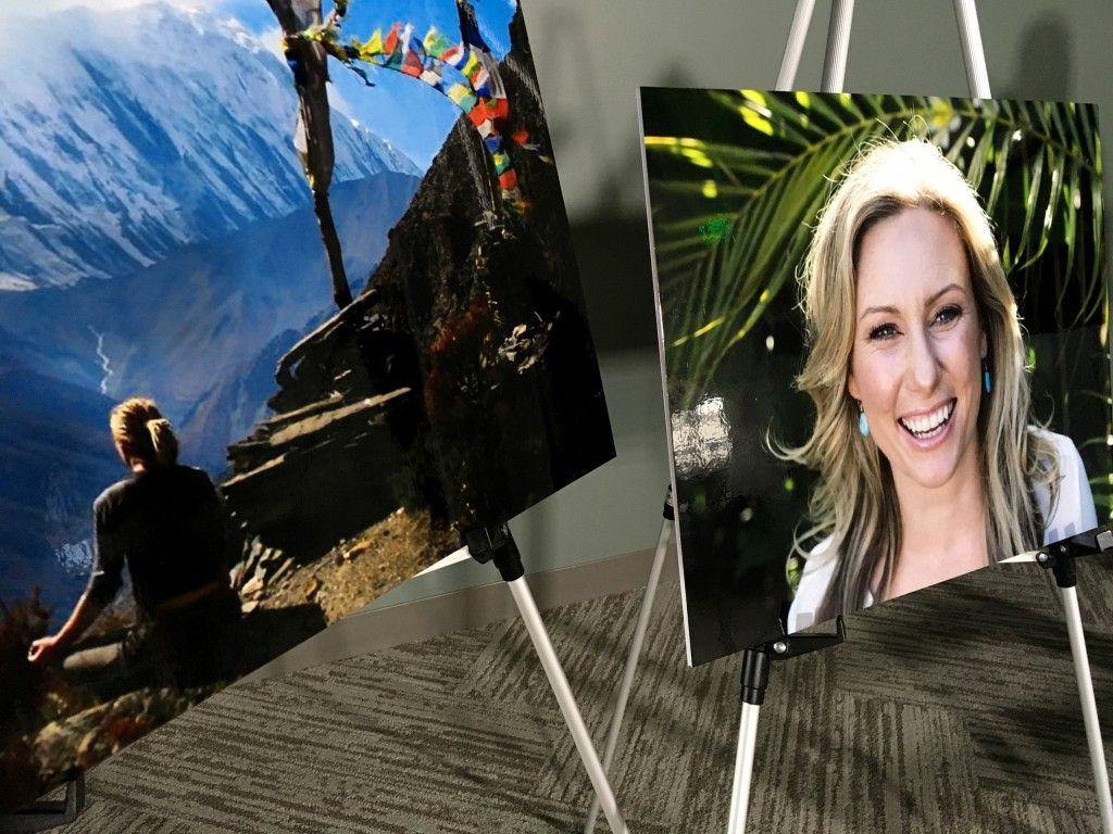 FILE - In this July 23, 2018, file photo, posters of Justine Ruszczyk Damond are displayed at a news conference by attorneys for her family in Minneap...