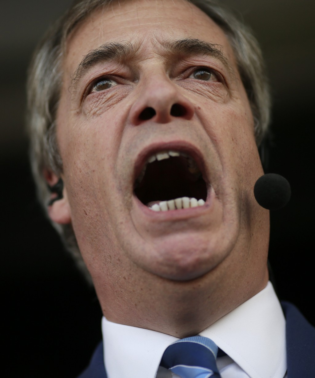 "Former UKIP leader Nigel Farage speaks at a rally in Parliament Square after the final leg of the ""March to Leave"" in London, Friday, March 29, 2019."