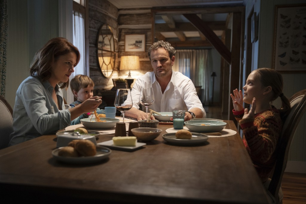 """This image released by Paramount Pictures shows Amy Seimetz, from left, Hugo Lavoie, Jason Clarke and Jeté Laurence in a scene from """"Pet Sematary."""" (K..."""