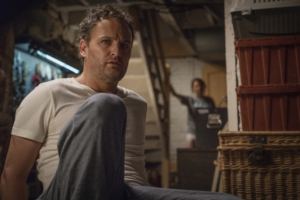 """This image released by Paramount Pictures shows Jason Clarke as Louis, left, and Amy Seimetz in a scene from """"Pet Sematary."""" (Kerry Hayes/Paramount Pi..."""