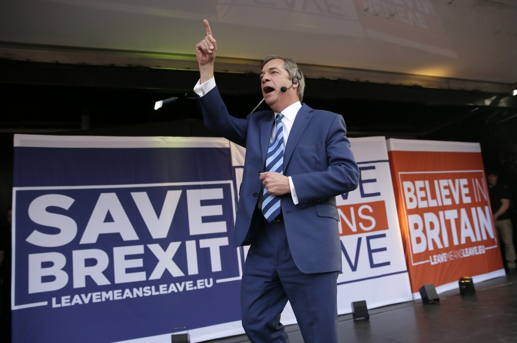 "Former UKIP leader Nigel Farage speaks at a rally in Parliament Square after the final leg of the ""March to Leave"" in London, Friday, March 29, 2019. ..."