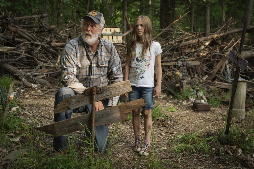 """This image released by Paramount Pictures shows John Lithgow, left, and Jeté Laurence in a scene from """"Pet Sematary."""" (Kerry Hayes/Paramount Pictures ..."""