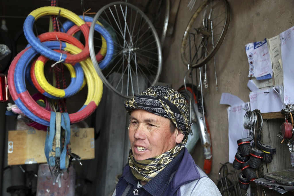 In This Wednesday, Feb. 20, 2019 photo, Mohammad Bakhsh, an ethnic Hazara bicycle repairman speaks during an interview with The Associated Press in He