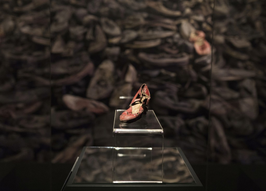 In this June 28, 2018 photo provided by Musealia Entertainment SL, a red dress shoe that belonged to an unknown woman who was deported to the Auschwit...