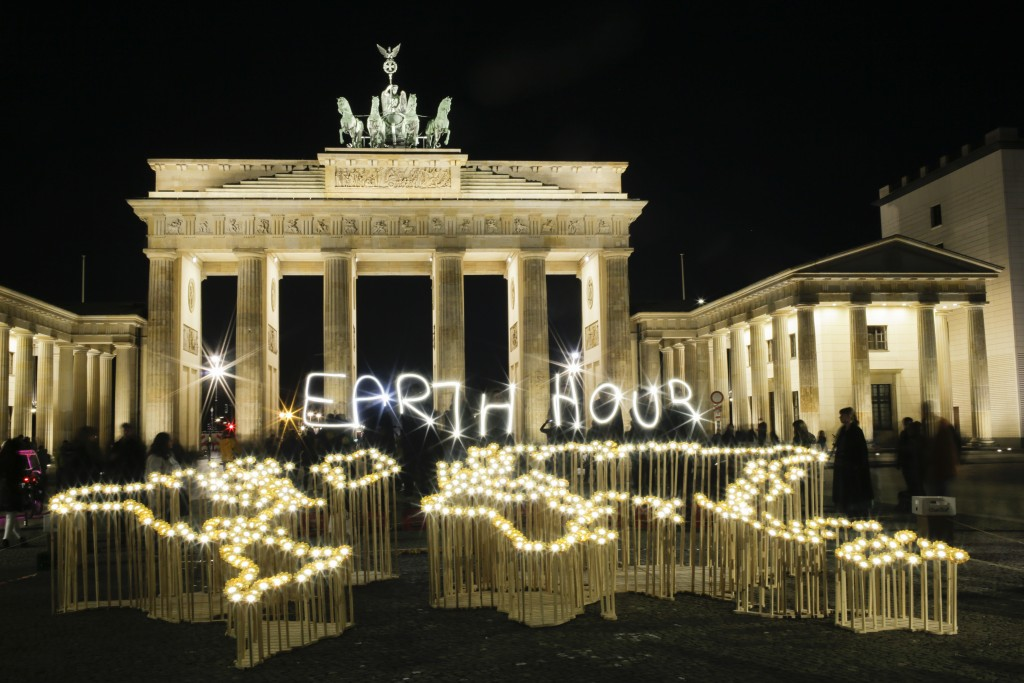Activists of the World Wide Fund For Nature (WWF) write the words 'Earth Hour' with led-lights in front of the Brandenburg Gate to mark Earth Hour, in...